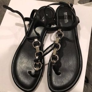 Black sandals with silver chain